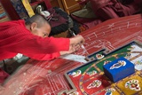 Buddhist Monk Working on a Sand Mandala  Temple of a 15th Century Monastery  Spitok  Ladakh  India