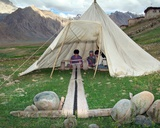 Weaver on Handloom in Tent on Edge of Remote Village in Himalayan Landscape  Pishu  Zanskar River…