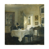 A Woman at a Table in a Dining Room