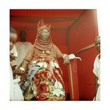 The Late Oba Akenzua II in Full Regalia  Including a Coral Garment and Headpiece