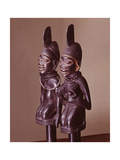 Dance Staffs Depicting Male and Female Devotees of Eshu  Identifiable by the Projection from…
