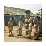 A Shrine of Shango  the Yoruba God of Thunder Furnished with Figures of Women Devotees
