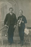 Two Young Men with Trumpets and One in Heilsarmee Uniform