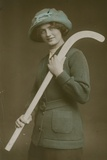Young Woman Carrying a Hockey Stick over Her Shoulder