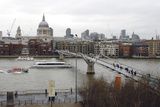The Millennium Bridge over the River Thames with St Paul's Cathedral in the Background  London  Uk