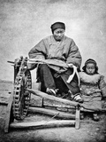 Woman and Child with Spinning Wheel  C1870s