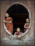Young monks in window of their monastery
