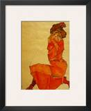 Kneeling Female in Orange Dress  c1910