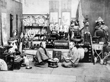 Japanese Shopkeepers with an Abacus  C1870s