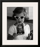 Caroline Kennedy holds a Postcard of her Father  1961