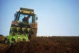 View of a Tractor Ploughing a Field