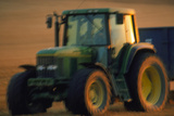 Time-exposure Image of a Tractor At Work
