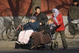 Elderly Chinese In Wheelchairs