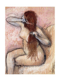 Nude Seated Woman Arranging her Hair
