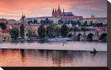 Charles Bridge across Vltava River with Hradcany Quarter and St Vitus Cathedral in Prague