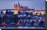 Charles Bridge across Vltava River with Hradcany Quarter and St Vitus Cathedral in Prague