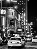Urban Scene with Yellow Cab by Night at Times Square  Manhattan  NYC  Black and White Photography