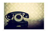 Vintage Old Telephone  Black Retro Phone Is On Wooden Table Over Green Old-Fashioned Wallpaper