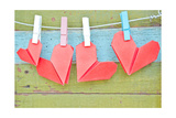 Paper Heart Hanging On The Clothesline On Old Wood Background