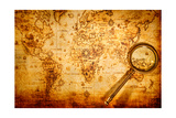Vintage Still Life Vintage Magnifying Glass Lies On An Ancient World Map
