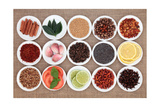 Large Spice  Herb And Food Ingredient Selection In White Porcelain Bowls Over Hessian Background