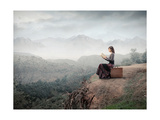 Woman Sitting On A Suitcase And Reading A Book With Landscape On The Background