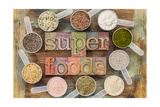 Superfoods Word In Letterpress Wood Type Surrounded By Plastic Scoops Of Healthy Seeds And Powders