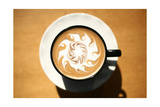 Latte Art  Designs Drawn With Steamed Milk In Hot Fresh Rich Coffee In A Ceramic Coffee Cup