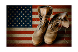 Army Boots On Sandy Flag Background