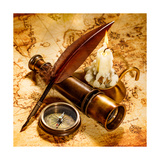 Vintage Compass  Quill Pen  Spyglass Lie On An Old Ancient Map With A Lit Candle