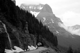 A Black And White Photo Of A Tunnel On The Going-To-The-Sun Road Of A Foggy Valley In Logan Pass