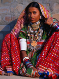 Ornately Dressed Megwar Tribe Woman Sits Next to Wall  Gujurat  India