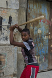 Adolescent Boy Hitting Baseballs in Downtown Street  Havana  Cuba