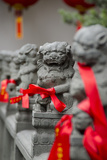 Stone Lions with Red Ribbon  Jade Buddah Temple  Shanghai  China