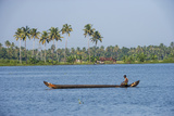 Man Rowing a Long Wooden Canoe  Backwaters  Kerala  India