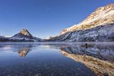 Canoe Glides on Two Medicine Lake  Glacier National Park  Montana  USA