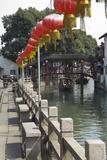 Boat in Canal with Old Wooden Bridge  Zhujiajiao  Shanghai  China