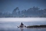 Otavalo Indian Fisherman in Reed Boat  Lake San Pablo  Andes  Ecuador