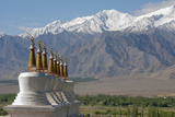 Chortens with Gold Spires Overlooking a Valley  Ladakh  India