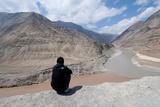 Man Sitting Above Zanskar and Indus River Confluence  Ledakh  India