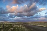 Sunset Clouds over Gravel Zumwalt Prairie Road  Oregon  USA