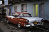 1950's Era Ford Fairlane and Colorful Buildings  Trinidad  Cuba