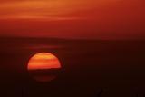 Orange Ball of the Setting Sun  Crescent Beach  Sarasota  Florida  USA