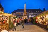 People Shopping at Christmas Market at Twilight  Wurzburg  Germany