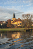 Morning Light on Church Along Main River  Germany