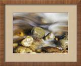 Water rushing past river stones