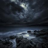 Black Rocks Protruding Through Rough Seas with Stormy Clouds  Crete  Greece