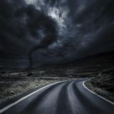 Tornado Near a Winding Road in the Mountains  Crete  Greece