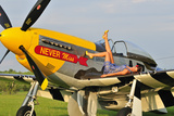 1940's Style Pin-Up Girl Lying on the Wing of a P-51 Mustang