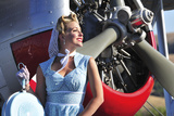 Close-Up of a 1940's Style Pin-Up Girl in Front of a Vintage F3F Biplane